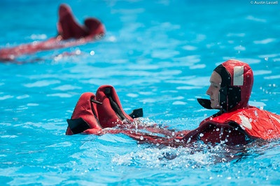 "A 3rd Company 2nd Platoon candidate practices swimming while wearing ""gumby suit"", during water survival training on July 16th, 2014."