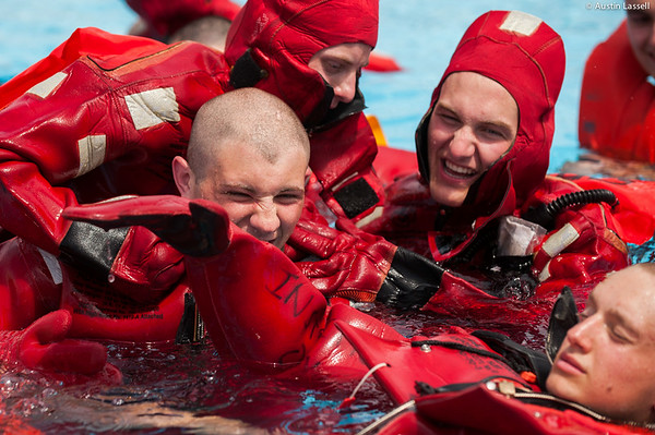 3rd Company 2nd Platoon candidates enjoy a lighter moment while wearing the cumbersome water survival equipment during water survival training on July 16th, 2014. During the  difficulty of indoctrination, strong bonds are forged, as seen in the photo,  between those who were likely complete strangers only a few weeks previous.