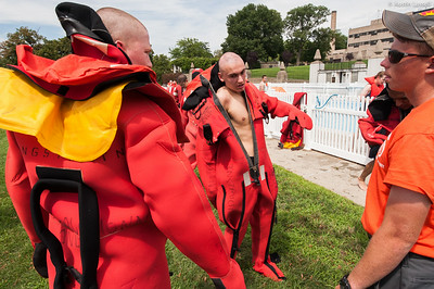 "3rd Company 2nd Platoon candidates attempt to don the cumbersome ""gumby suits"" during water survival training on July 16th, 2014."