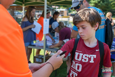 Kids ages 7-16 gathered at the Wilson Park pool and trail on Friday evening for Fayetteville's Splash and Dash Aquathlon.