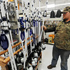 Globe/T. Rob Brown<br /> Nacona Scott, of Miami, Okla., looks over the spoonbill/paddlefish rod and reel selection Friday morning, March 22, 2013, at the Miami Walmart store.