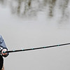 Globe/T. Rob Brown<br /> Kristal Lee, of Stillwater, Okla., fishes for paddlefish, or spoonbills, in the Neosho River on the south side of Miami, Okla., Friday morning, March 22, 2013. The spoonbill run is underway with events starting today.