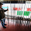Globe/T. Rob Brown<br /> Amos Owen, of Bernice, Okla., looks over the selection of rods and reels for paddlefish, or spoonbills, at Treasure Hunt, a Miami, Okla., store Friday morning, March 22, 2013.