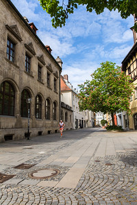Lonely top runner on his second lap in the historic center of Regensburg