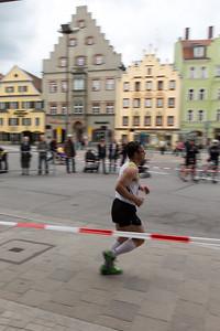 runner in the historic center of Regensburg.