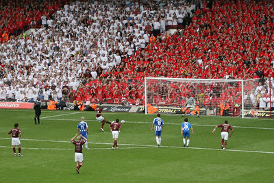 Thierry Henry scores the last goal for Arsenal at Highbury in a league match against Wigan (May 2006)