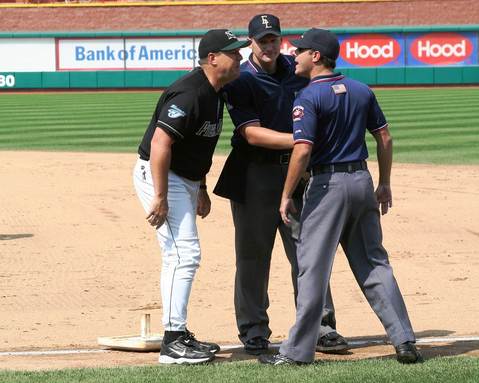 New Hampshire manager Mike Basso and first base umpire Brian Reilly say goodbye as plate umpire looks on.