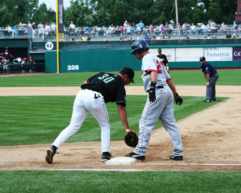 Fishercats 1B Clint Johnston applies tag to SeaDogs Raul Nieves.