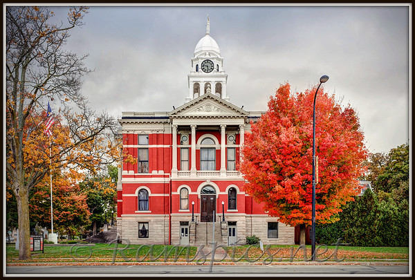 Updated (fall 2012) image of the historic 1885 Eaton County courthouse in downtown Charlotte, Michigan. Photograph was taken near dusk, resulting in unique, fleeting light, that accentuates the colors of the square ! I've taken dozens and dozens of photos of this building over the years... 2012 version is now my favorite.