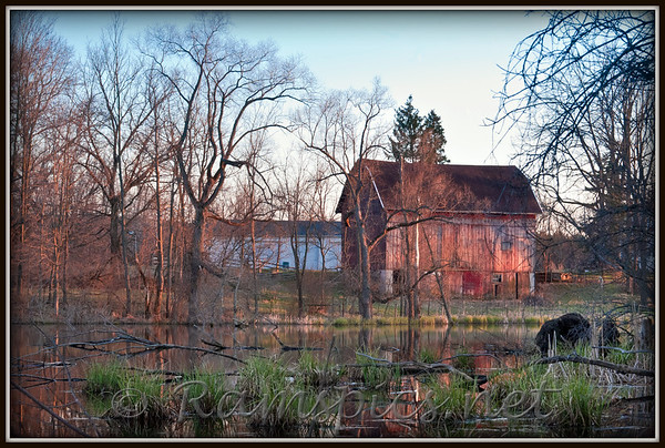 Mid Michigan barn with pond at sunset.