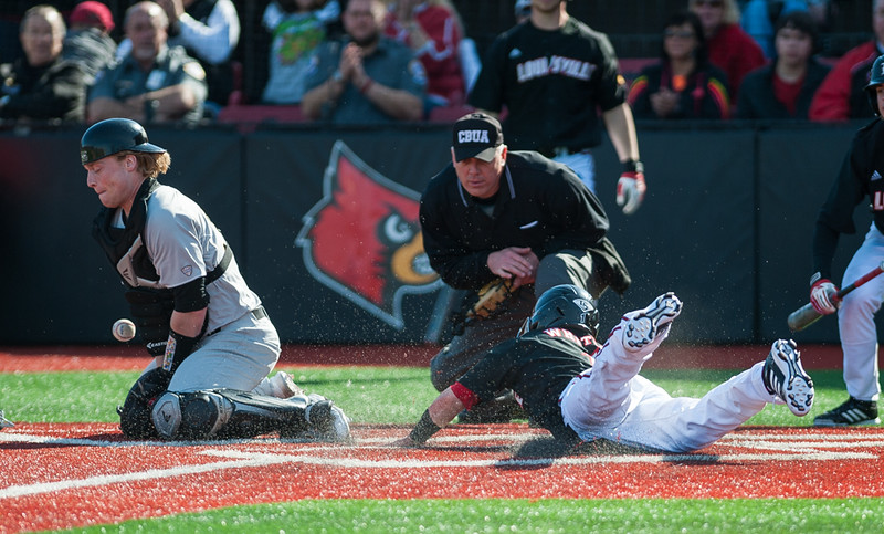 University of Louisville Men's Baseball team playing during a regular season game for the University of Louisville VS Western Michigan on 2-22-14 at Jim Patterson Stadium in Louisville Kentucky.