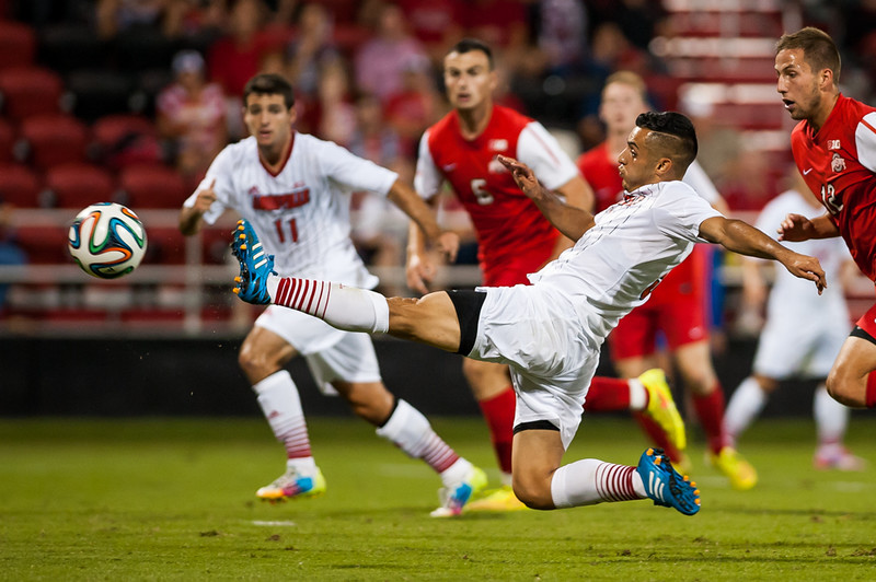 Ricardo Velazco (no. 9) of the men's soccer team takes a shot on goal while playing in a regular season game for the University of Louisville VS Ohio State on 9-30-14 in Louisville, Kentucky at Lynn Stadium.