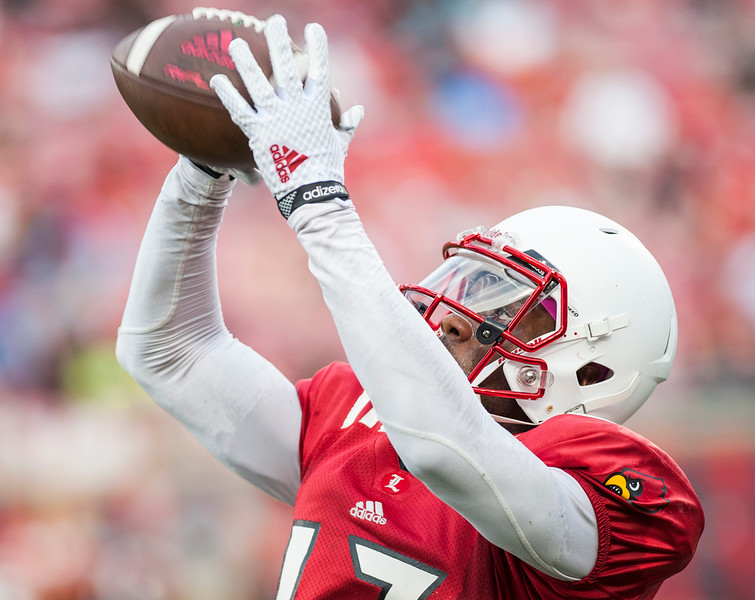 University of Louisville wide receiver No. 17 James Quick makes a completion during the Spring 2015 football red VS white scrimmage  on 4-17-15 at Papa Johns Cardinal Stadium in Louisville, KY. Crowd turnout for the scrimmage was decent, but not record breaking, indeed, the scrimmage took place a day prior to a major Louisville event, a Kentucky Derby Festival event, Thunder Over Louisville.