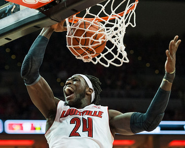 Montrezl Harrell (no. 24) of the men's basketball team making a dunk while playing in the final regular season game for the University of Louisville VS University of Virginia on senior night on 3-7-15 in Louisville, Kentucky at the KFC Yum Center. When playing against the Cavaliers, the Cards were ranked No. 16 while the Cavaliers were ranked No. 2. With only seconds on the clock and down one point, Mangok Mathiang (no. 12), playing for the Cards, shooting his only shot in the game, scored a jumper from near the free throw line to pull the Cards into the lead. The game was a substantial win for the Cards given that the season had been a rough one despite their fair, but not great ranking. This was the Cards first season in the ACC, full of tough rivals, but this was not the greatest source of their woes. With only a few games left in the season, key, star player Chris Jones (no. 3) was released from the team, leaving a crucial gap in the Card's defense. Fighting against the odds and making up for several difficult losses following the loss of Jones, the Cards showed up and made the win.