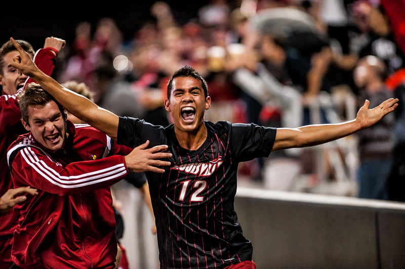 Jerry Ramirez (no. 12) and other members of the men's soccer team celebrate following the game winning shot scored by Ramirez in overtime during a regular season game for the University of Louisville VS Syracuse on 10-17-14 in Louisville, Kentucky at Lynn Stadium.