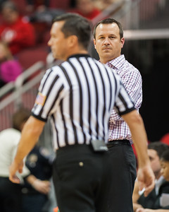 Head coach Jeff Walz of the women's basketball stares down the referee following technical foul that was called on him during a regular season game for the University of Louisville VS Miami on 1-25-15 in Louisville, Kentucky at the KFC Yum Center.