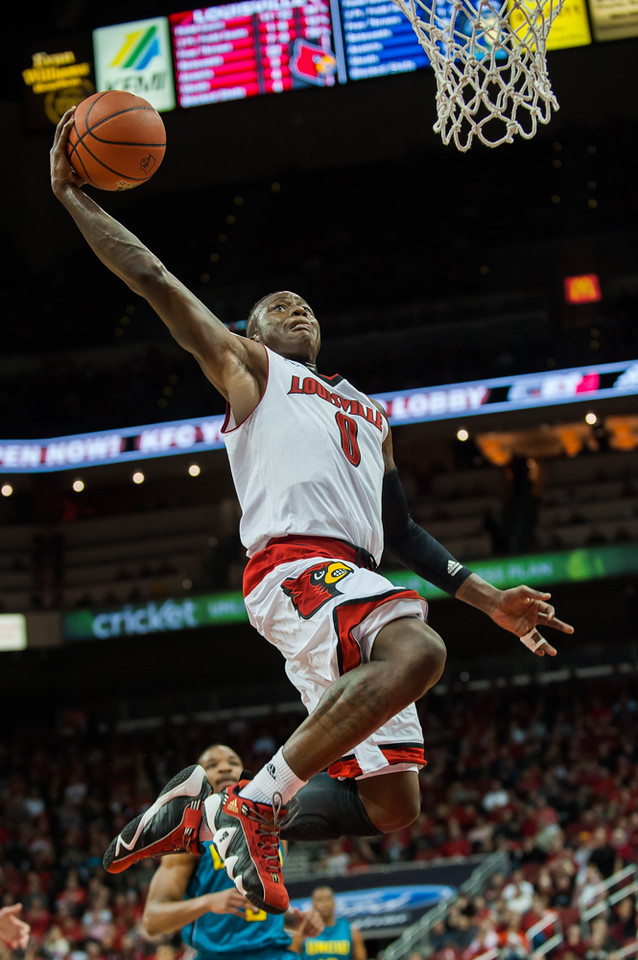 Terry Rozier (no.0) of the men's basketball team playing in a regular season game for the University of Louisville VS University of North Carolina Wilmington on 12-15-14 in Louisville, Kentucky at the KFC Yum Center.