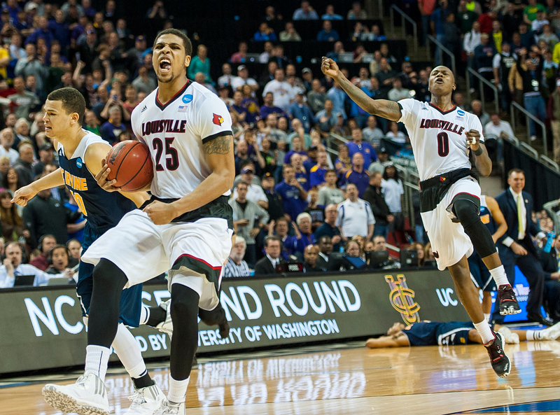 """University of Louisville's Wayne Blackshear No. 25 and Terrry Rozier No. 0, celebrate a hard fought win against the thirteen seed UC Irvine Anteaters in the 2015 NCAA Division I Men's Basketball Tournament 2nd Round game on 3-20-2015 at Key Arena in Seattle, Washington. The Anteaters were a low ranked team among the East region, especially as compared to Louisville, thirteenth versus fourth, but they proved to be a formidable adversary. With the help of No. 34 Mamadou Ndiaye, the 7' 6"""" tallest player in the NCAA, the Anteaters gave the Cards a run for their money keeping within a shot of winning or tying for the last several minutes of the game. With the Cards up by two points, in the final seconds of the game, the Anteaters had the ball and were making a go at scoring, but Terry Rozier made a steal and passed on the ball to Wayne Blackshear the moments before the clock ran out."""