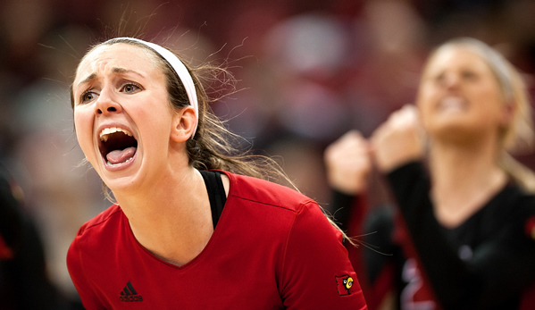 Roxanne McVey (no. 15) of the women's volleyball celebrates following a play in a regular season game for the University of Louisville VS Virginia on 11-2-14 in Louisville, Kentucky in the KFC Yum Center.