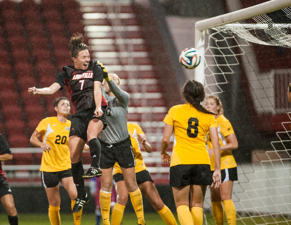 Kari Weinland (no. 7) of the women's soccer team heads in the winning goal, for a 1-0 score, during a regular season game for the University of Louisville VS NKU on 10-15-14 in Louisville, Kentucky at Lynn Stadium.