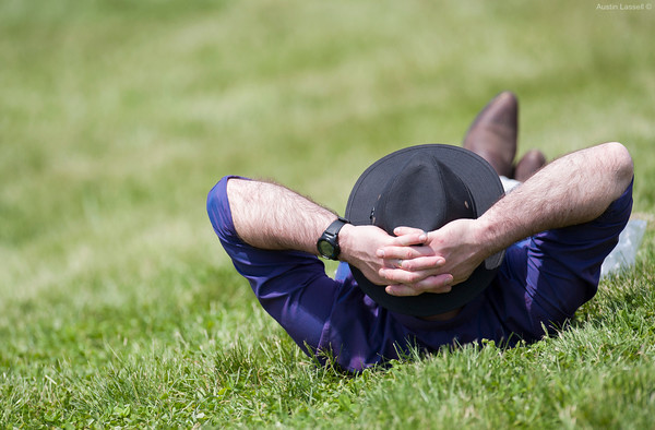 A fan takes a break during a long day at Churchill Downs on Derby Day. The infield has its advantages and disadvantages. Arriving early is a must for good position near the track, but the infield allows guests to sprawl out and take a nap, a luxury not available to the immensely more expensive premium seating with a better view of the track.
