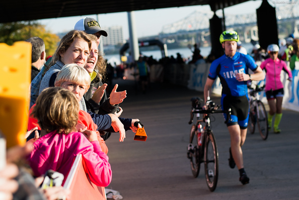 Fans cheer on 2015 Ironman Louisville contestants as they head towards the beginning of the cycling portion of the race.