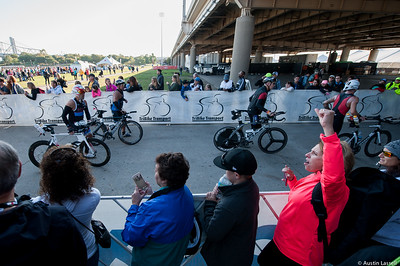 A spectator cheers on Ironman Louisville 2016 contestants at the start of the cycling portion of the race. The Ironman Louisville 2016 took place on 10-9-16 and is the 10th anniversary of the race occuring yearly in Louisville, Kentucky.