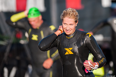 An Ironman Louisville 2016 contestant begins prepping for the next phase of the race moments after exiting the water at the completion of the swimming portion of the race. The Ironman Louisville 2016 took place on 10-9-16 and is the 10th anniversary of the race occuring yearly in Louisville, Kentucky.