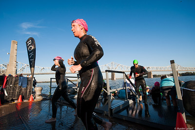 Ironman Louisville 2016 contestants exit the Ohio River at the completion of the swimming portion of the race. The Ironman Louisville 2016 took place on 10-9-16 and is the 10th anniversary of the race occuring yearly in Louisville, Kentucky.