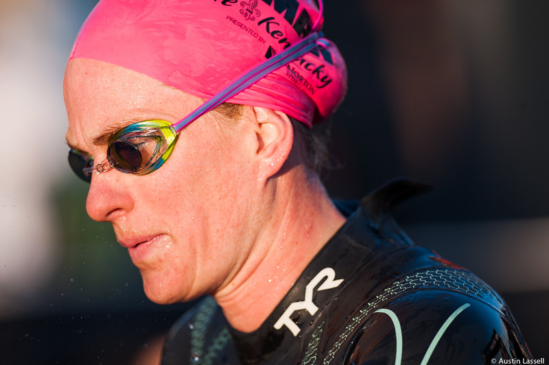 An Ironman Louisville 2016 contestant  moments after exiting the water at the completion of the swimming portion of the race, heads towards the next phase of the triathalon, cyclying. The Ironman Louisville 2016 took place on 10-9-16 and is the 10th anniversary of the race occuring yearly in Louisville, Kentucky.