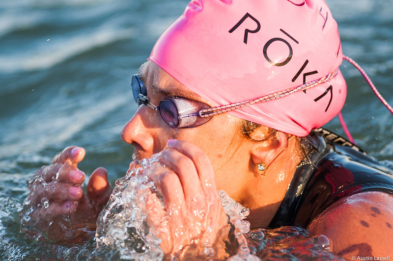 Ironman Louisville 2016 contestant no. 347, Jenn Kunklinski, reaches for her fogged goggles as she nears the competion of the swimming portion of the race. Jenn is a 34 year old from Alabama who placed second in the 30-34  division and 27th overall in swimming. She finished top ten in her division in the other two portions of the race and top 325 overall. The Ironman Louisville 2016 took place on 10-9-16 and is the 10th anniversary of the race occuring yearly in Louisville, Kentucky.