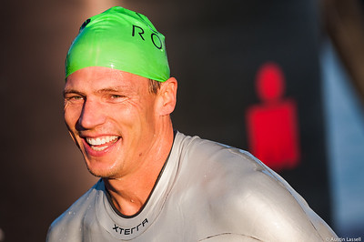 Ironman Louisville 2016 contestant no. 139, Joe Langel, smiles moments after exiting the water at the completion of the swimming portion of the race while heading to the next phase of the triathalon, cyclying. Joe is a 43 year old from Minnesota who placed in 20th in the 40-44 division and top 100 overall in swimming. He finished top 100th in all portions of the race within his division and top 600 overall. The Ironman Louisville 2016 took place on 10-9-16 and is the 10th anniversary of the race occuring yearly in Louisville, Kentucky.