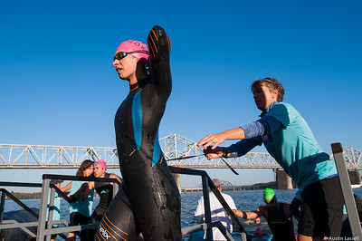 An Ironman Louisville 2016 contestant exit the Ohio River at the completion of the swimming portion of the race. The Ironman Louisville 2016 took place on 10-9-16 and is the 10th anniversary of the race occuring yearly in Louisville, Kentucky.