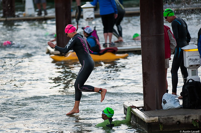 An Ironman Louisville 2016 contestant leaps into the water at start of the swimming portion of the race. The Ironman Louisville 2016 took place on 10-9-16 and is the 10th anniversary of the race occuring yearly in Louisville, Kentucky.