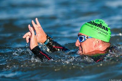 An Ironman Louisville 2016 contestant makes the rockstar gesture towards spectators nearing the completion of the swimming portion of the race. The Ironman Louisville 2016 took place on 10-9-16 and is the 10th anniversary of the race occuring yearly in Louisville, Kentucky.