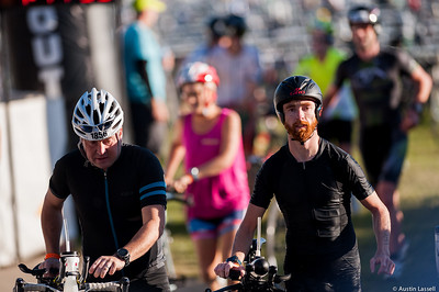 Ironman Louisville 2016 contestants no.s 1856 and 403, Ryan Lucas and James Rasmussen, leave the cycling transition area at the start of the cycling portion of the race. James is a 30 year old from Utah who placed in the top 200 for all portions of the race within the 30-34 division. Ryan is a 36 year old from Michigan who completed the swimming portion of the race within the top 135 of the 35-39 division. The Ironman Louisville 2016 took place on 10-9-16 and is the 10th anniversary of the race occuring yearly in Louisville, Kentucky.