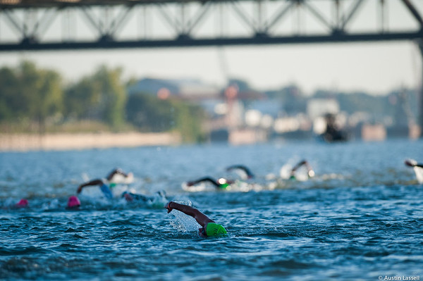 Ironman Louisville 2016 contestant no. 311, Jimi Young, (in front) and other contsestants swim down the Ohio River in the swimming portion of the race. Jimi is a 47 year old from Michigan who placed within the top 105 in all portions of the race within the 45-49 division and top 475 overall. He also finished top 150 overall within the cycling portion of the race. The Ironman Louisville 2016 took place on 10-9-16 and is the 10th anniversary of the race occuring yearly in Louisville, Kentucky.