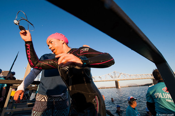 An Ironman Louisville 2016 contestant exits the Ohio River and removes her goggles at the completion of the swimming portion of the race. The Ironman Louisville 2016 took place on 10-9-16 and is the 10th anniversary of the race occuring yearly in Louisville, Kentucky.