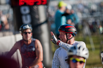 Ironman Louisville 2016 contestant no. 325, Peter Torok, waves to a spectator as he leaves the cycling transition area at the start of the cycling portion of the race. Peter is a 49 year old from Indiana who placed 10th in swimming within the 50-54 division. The Ironman Louisville 2016 took place on 10-9-16 and is the 10th anniversary of the race occuring yearly in Louisville, Kentucky.