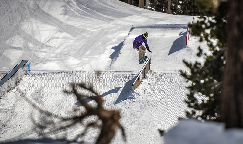 Snowboarder going for a 50-50 Main Snowpark Mammoth Mountain