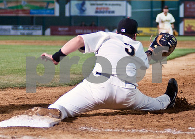 Ryan White stretches to make final out of the game.