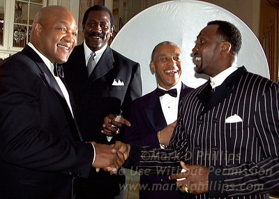 """George Foreman, former heavyweight champion, after receiving the Arthur Ashe Award for Community Service on April 21 at Sports Ball '98, the annual fund raising gala for the Arthur Ashe Institute for Urban Health (AAIUH) at the Waldorf Astoria in New York. With him are former 1968 Olympic teammate Spencer Haywood; Edgar Mandeville, CEO, The Arthur Ashe Institute for Urban Health, and fellow boxing great Thomas """"The Hit Man"""" Hearns. For more info: Kathryn Hamilton  914-232-5446 Photo by Mark D. Phillips   www.stellarimages.com/sportsball"""