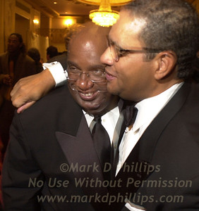 Al Roker and Bryant Gumbel share a hug at Sportsball 2002, the annual award and fundraising event for the Arthur Ashe Institute for Urban Health held at the Waldorf=Astoria in New York on Wednesday.  Photo by Chuck Bigger/StellarImages.com
