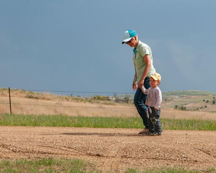 Kaye and child walk gravel road