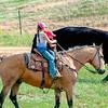roundup girl and little boy on horseback