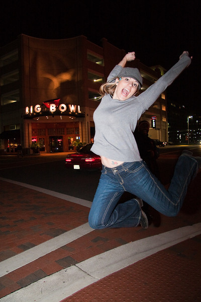 Marcy Kellar jumping infront of the roanoke va big bowl. Just after speaker dinner.  Fabian in the background cracking me up.