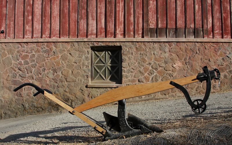 Plow and barn
