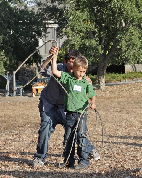 Andre helping Enzo with roping