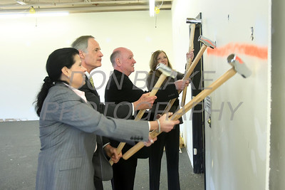 Julie Hester, Bishop Malooly, Sen. Tom Carper, and Rita Landgraf put their ceremonial sledgehammer into a wall during a press conference to announce the new space for St. Francis Healthcare Life program at the Shipyard Center on the Riverfront, Monday, March 26, 2012 photo/ http://www.DonBlakePhotography.com