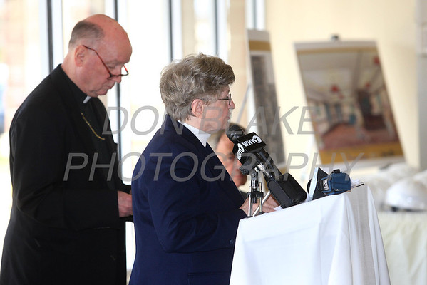 Sr. Christa Marie Thompson says a prayer with Bishop Malooly by her side at the new space for St. Francis Healthcare Life program at the Shipyard Center on the Riverfront, Monday, March 26, 2012 photo/ www.DonBlakePhotography.com